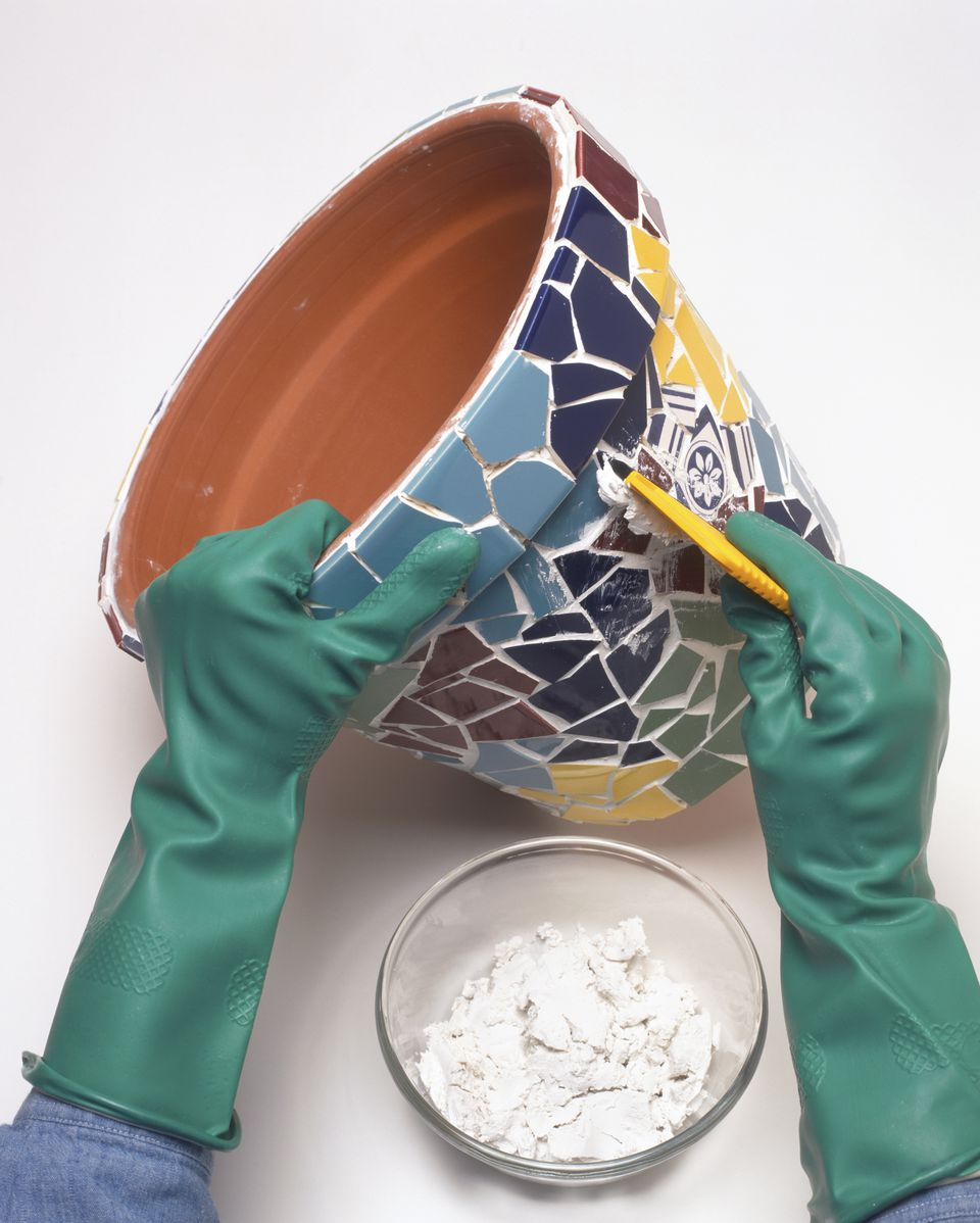 Using grout on mosaic pot