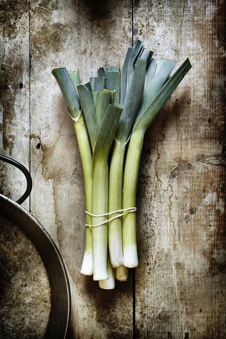 Cut leeks on a wooden board