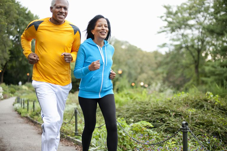 Older couple jogging in the park