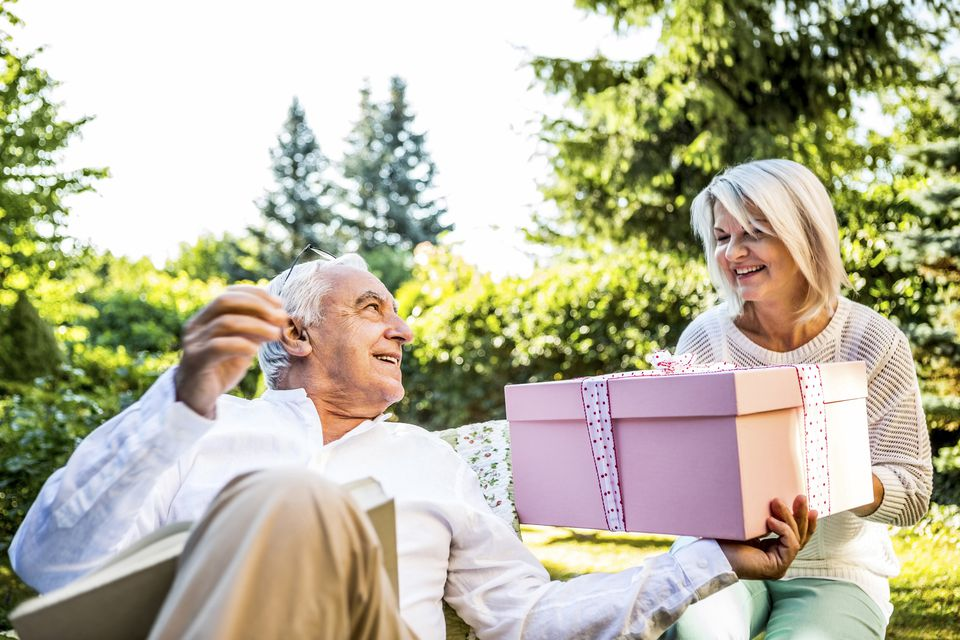 Couple exchanging anniversary gifts