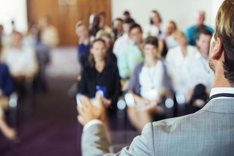 speaker speaking to room full of people