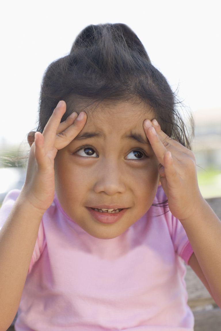 USA, California, Girl (4-5) with headache