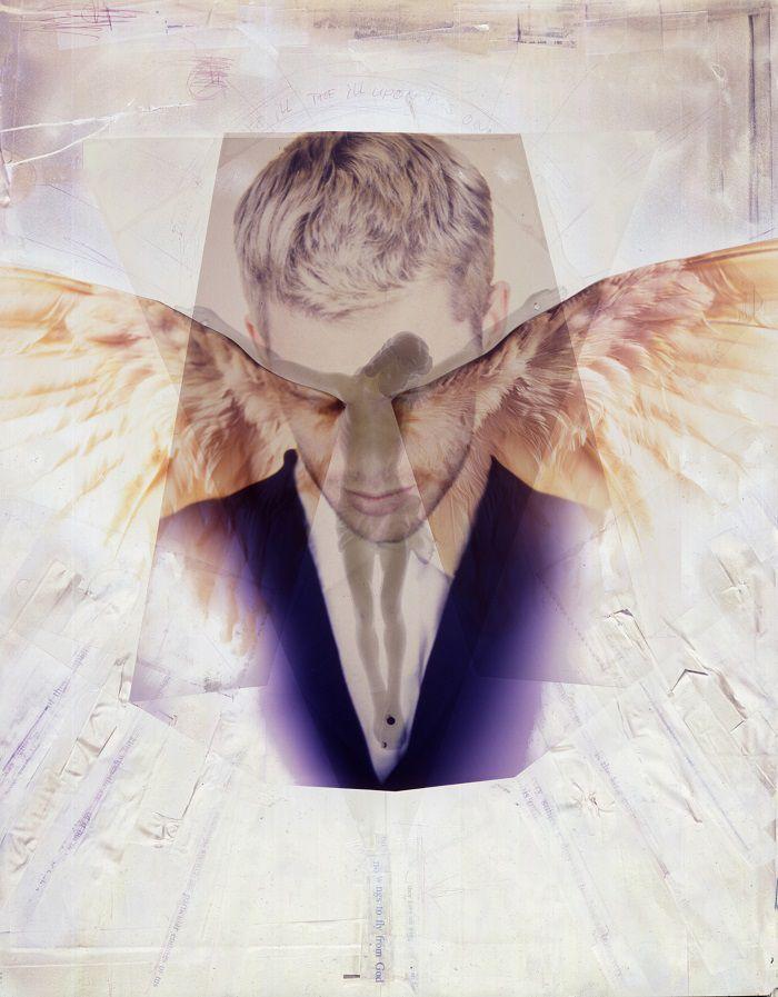 saint man praying to angels