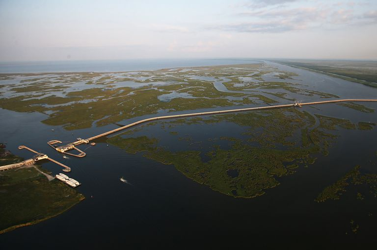 waterway delta cut with a manmade barrier with openings