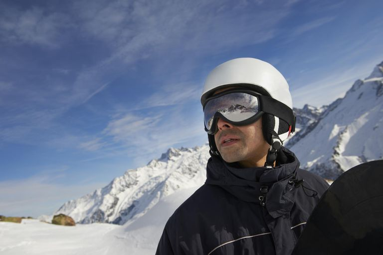 Male snowboarder looking over Chamonix, Mont Blanc