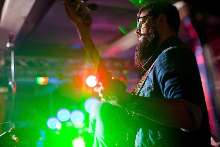 Man playing guitar in bar