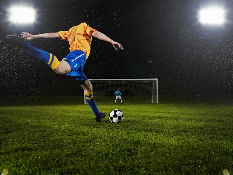 soccer player about to strike penalty kick