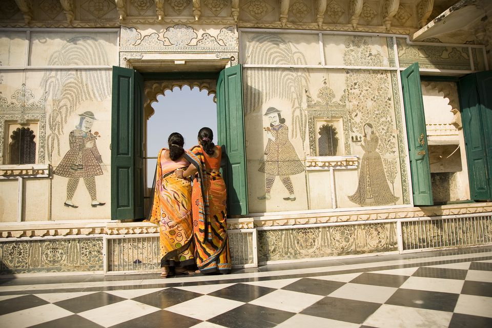 Women looking at Lake Pichola from City Palace, Udaipur.