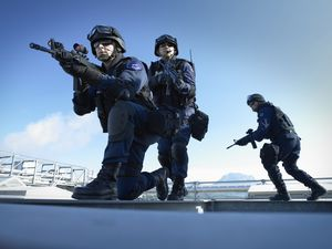 SWAT police unit with automatic rifles