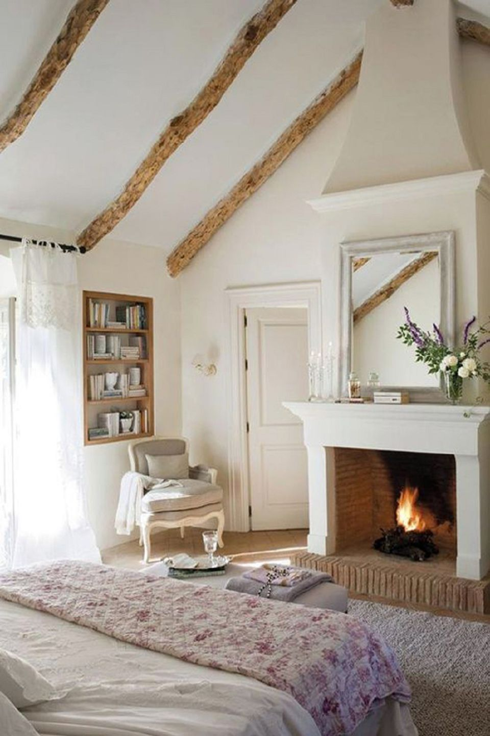 Fireplace in country bedroom