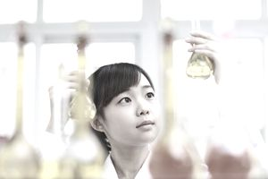 Pretty college student in chemistry lab