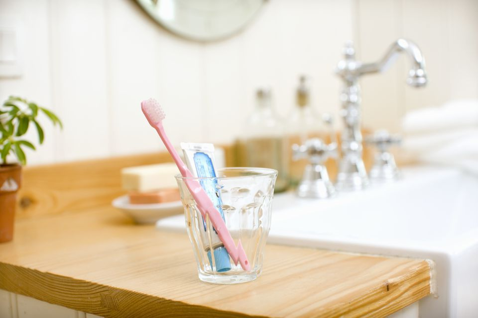 Tooth polish set put on wash basin