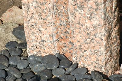 Polished river rock provides a nice accent at the base of the fountain.