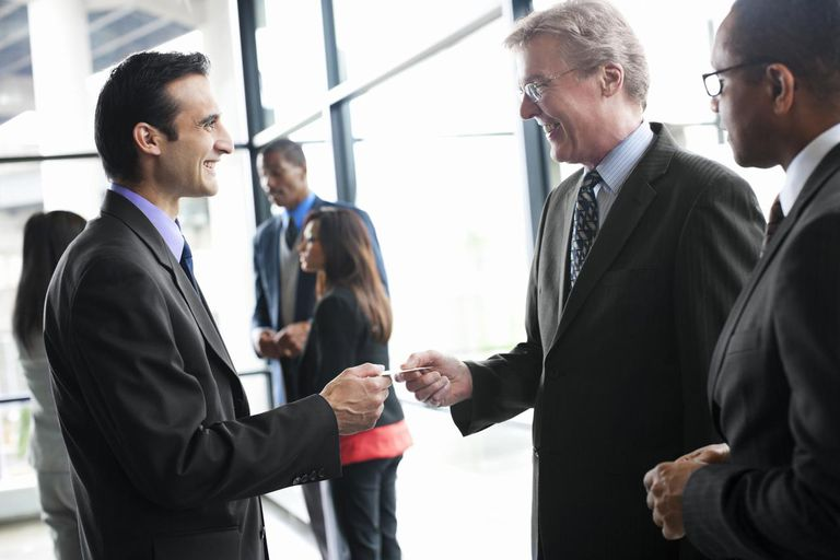 Businessmen at Networking Event Exchanging Business Cards