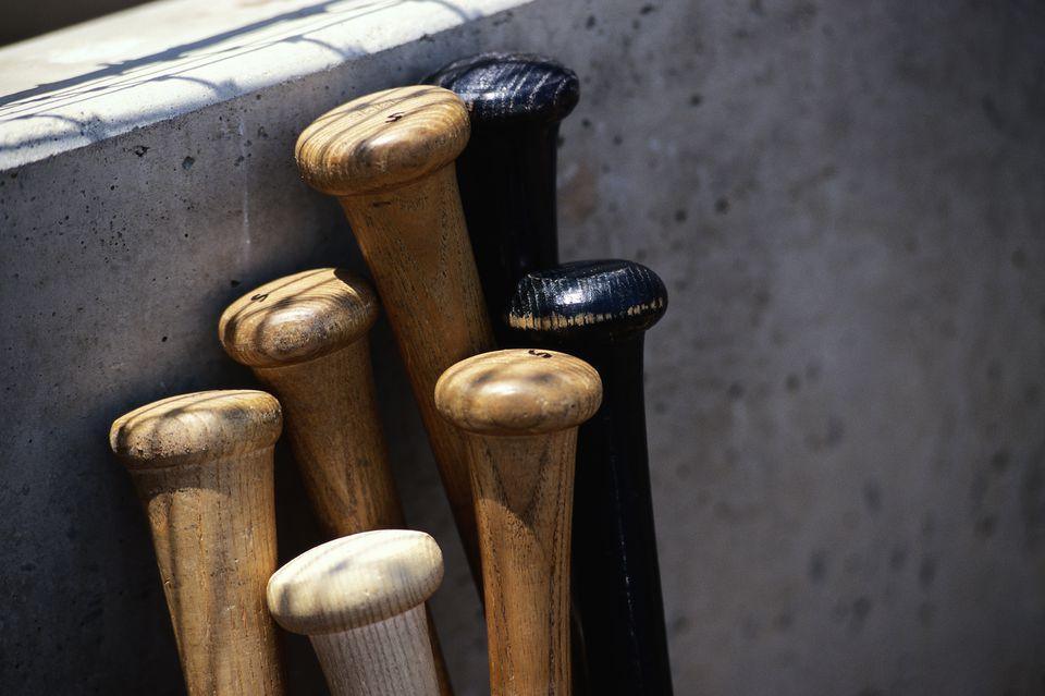 Baseball bats leaning on wall