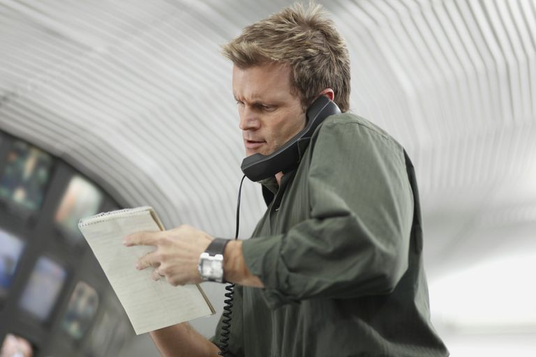 A picture of a reporter taking notes