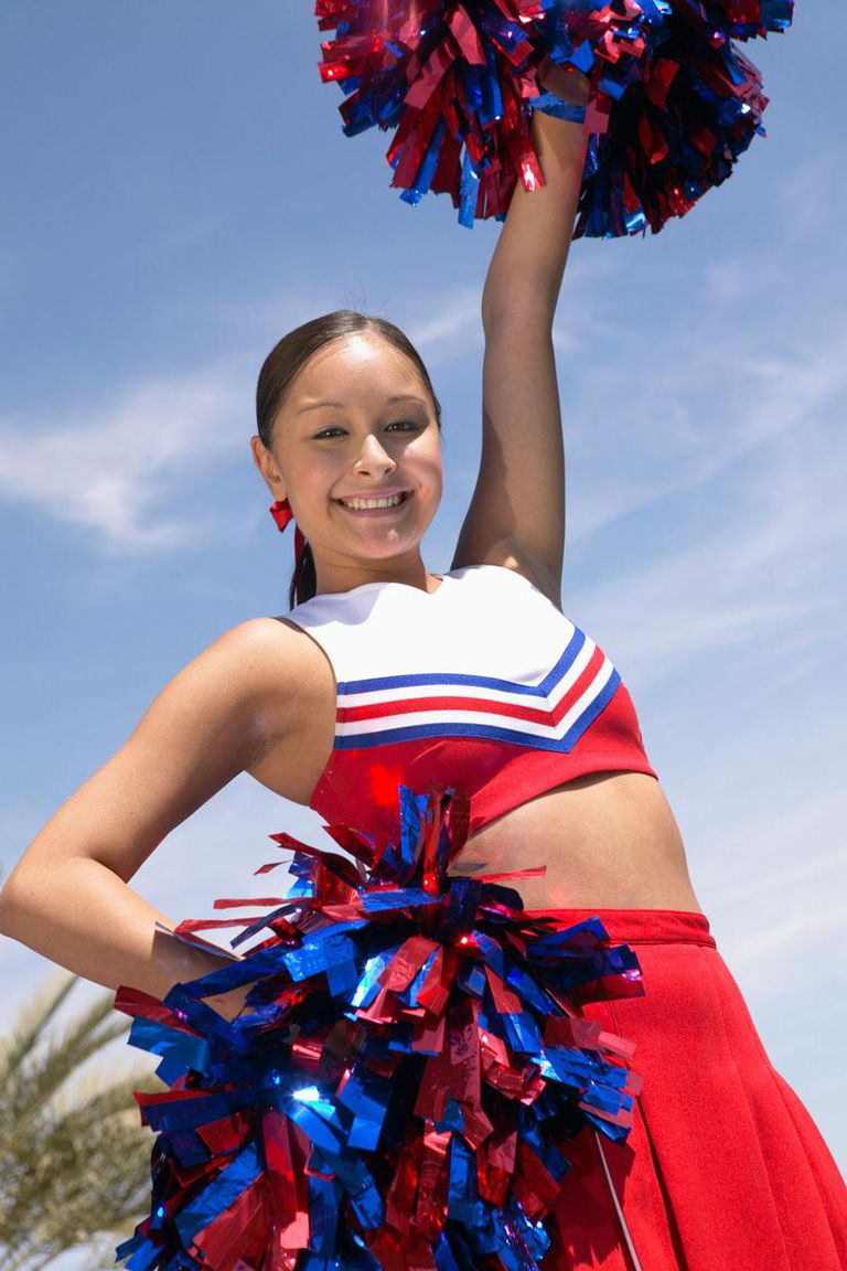 Portrait of a Teenage Cheerleader Holding Pompoms