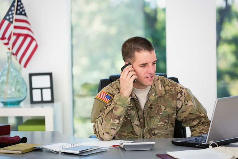 Army guy on the phone with laptop