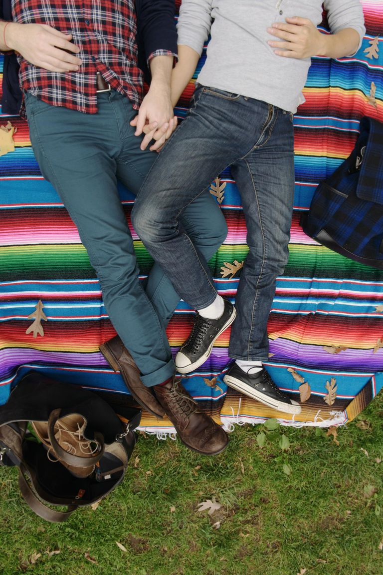 Gay couple on rainbow blanket