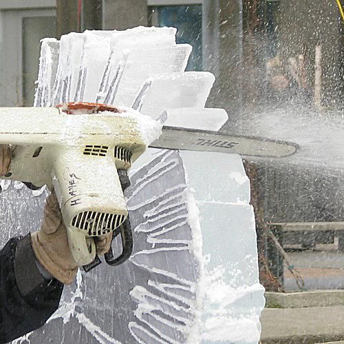 A chainsaw is used to sculpt ice at Bloor-Yorkville Icefest
