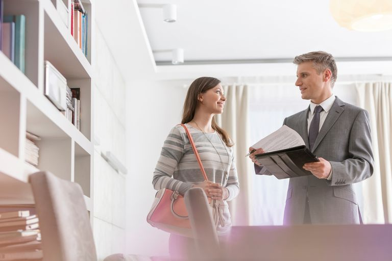woman with male real estate agent