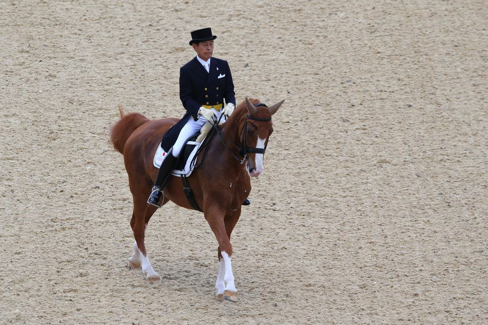 Hiroshi Hoketsu of Japan riding Whisper riding Grandioso competes in the Dressage Grand Prix on Day 6 of the London 2012 Olympic Games at Greenwich Park on August 2, 2012 in London, England.