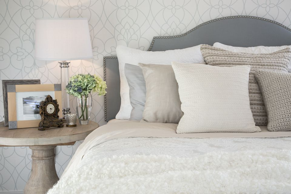 Decorate the bedroom with gray plus creamy white and tan.
