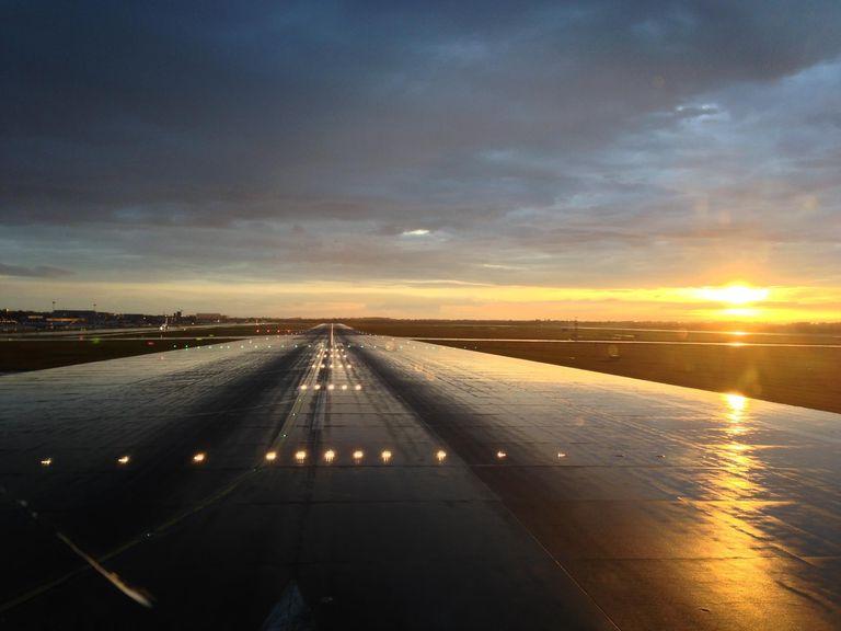 Illuminated runway at dusk