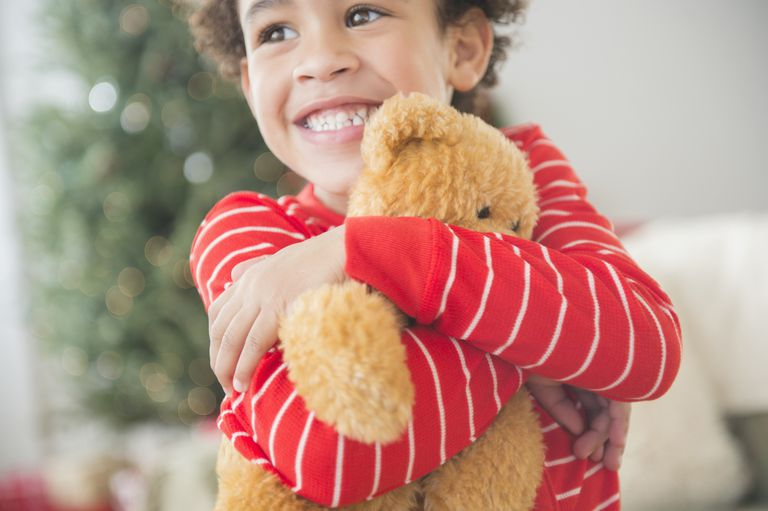Boy hugging a teddy bear on Christmas
