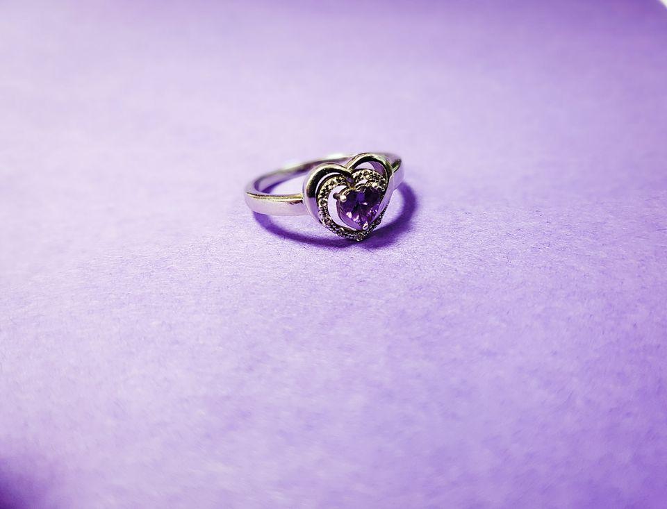 Wedding ring against purple background
