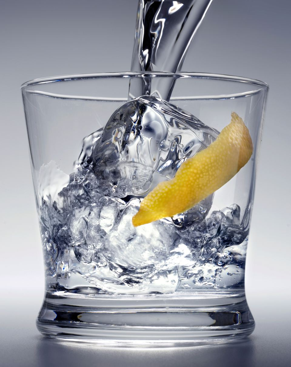 Pouring vodka over ice