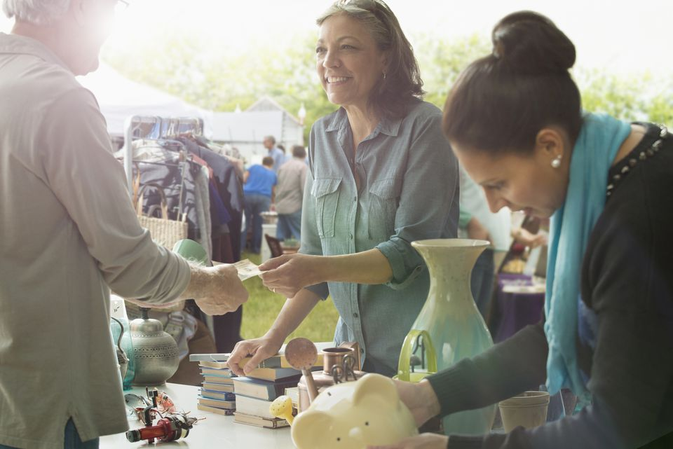 Hispanic women shopping at flea market