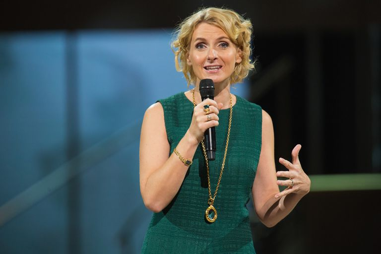 Elizabeth Gilbert on stage with microphone