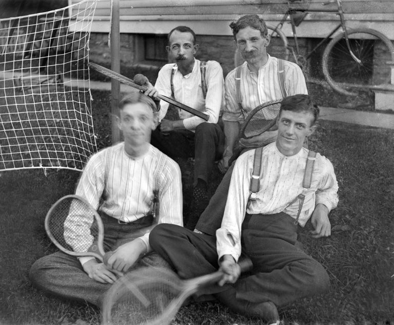Four guys ready to play doubles tennis, ca. 1905