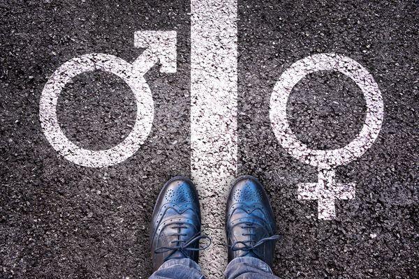 Legs with gender symbol on asphalt, gender concept