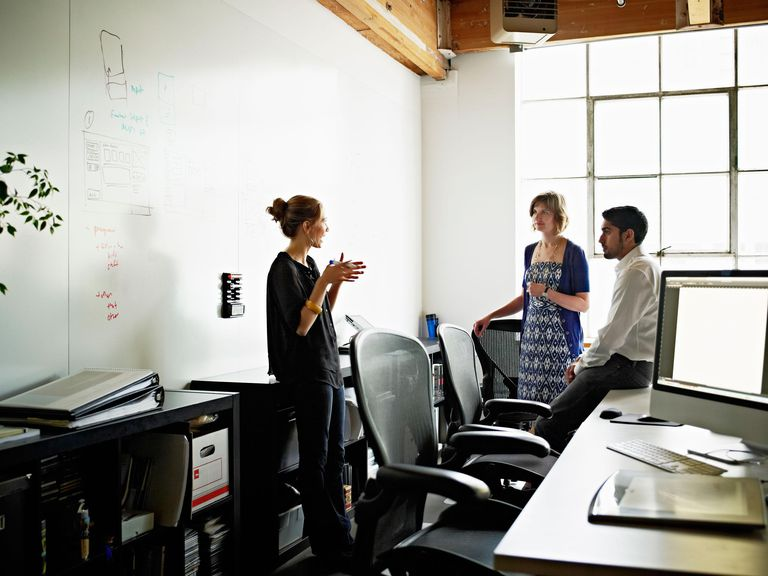 Coworkers in discussion over project in high tech startup office