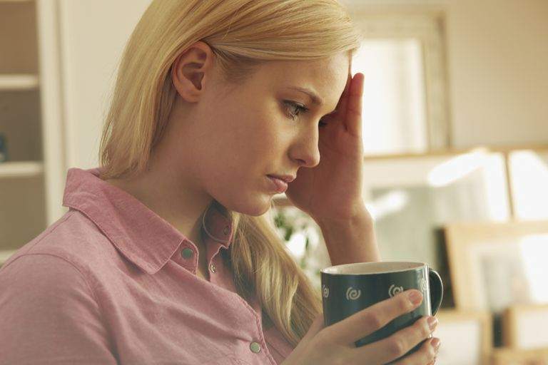 Young woman holding hot drink