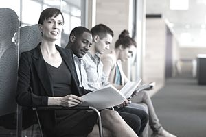 Four people waiting for an interview