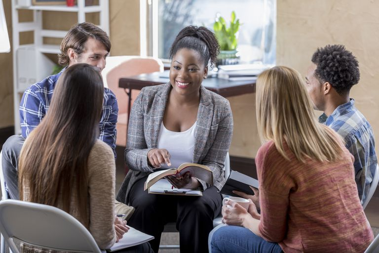 Beautiful African American leads diverse Bible study group