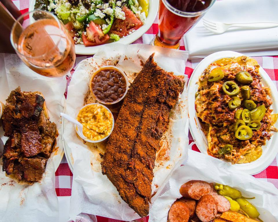 An overhead view of a table of barbecue dishes