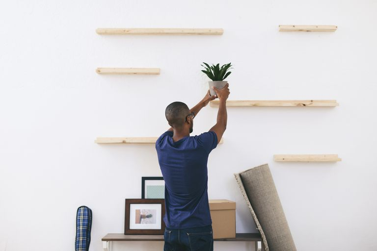 Young man moving into apartment