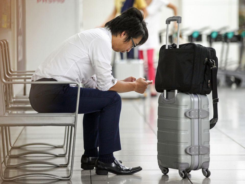 Smartphones abound in airport terminals.