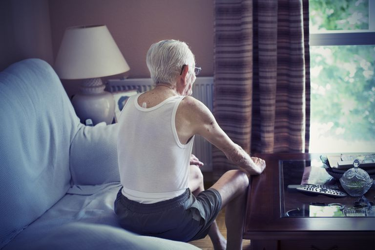 Telomere theory of aging. Elderly man looking out window