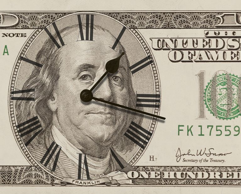 Clock on one hundred dollar bill