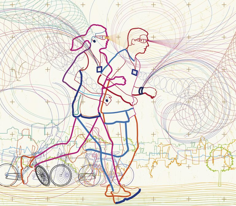 Man and woman running together in city using fitness activity trackers