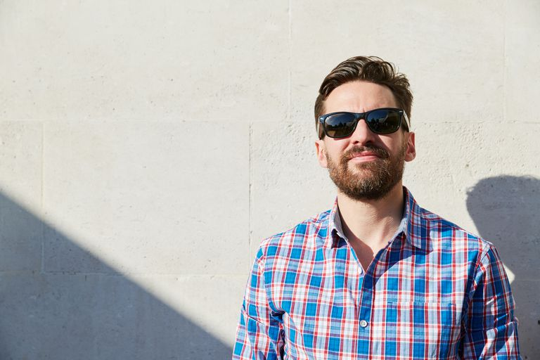 bearded man wearing sunglasses outdoors