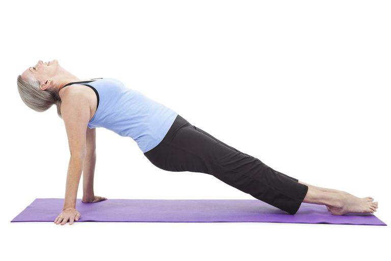 Starting the Pilates leg pull back.