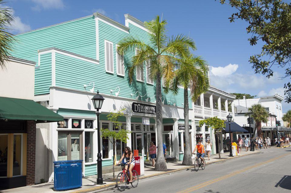 USA, Florida, Key West, Cyclists riding along Duval Street