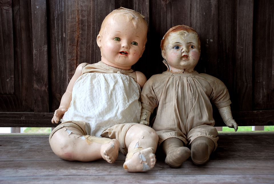 Dolls Against Wooden Wall