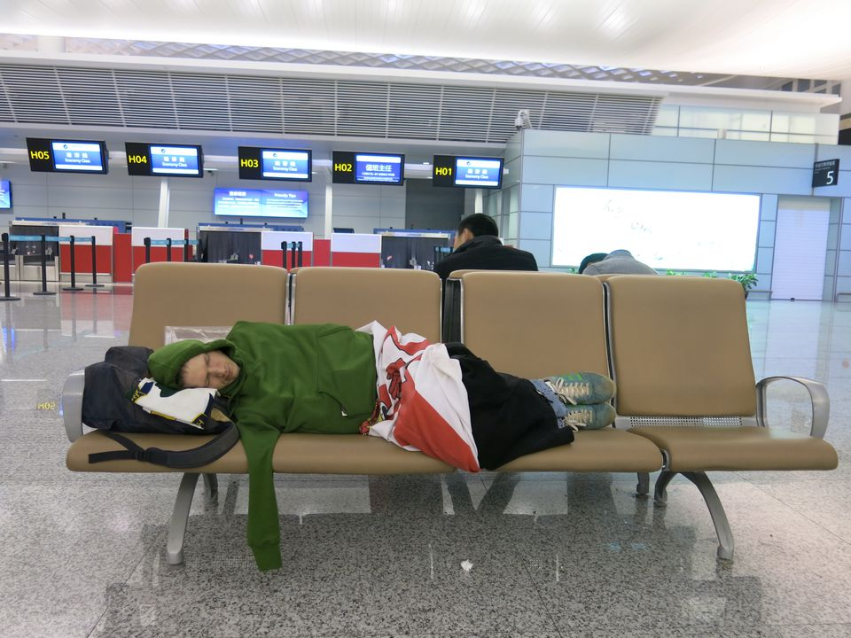 Sleeping in an airport.